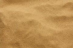 Текстура предпосылки песка Стоковые Фотографии RF