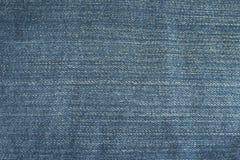 Текстура предпосылки голубых джинсов Стоковая Фотография