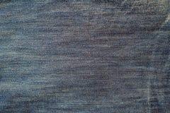Текстура предпосылки голубых джинсов Стоковые Изображения