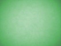 Текстура предпосылки зеленого цвета виньетки как рамка с белой тенью в середине Стоковое Изображение RF