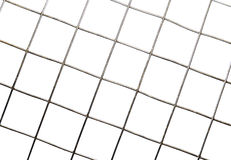 Текстура предпосылки изолированных клеток сетки металла Стоковое фото RF
