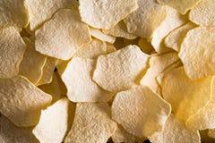 Текстура предпосылки испеченных печью картофельных стружек Стоковое Изображение