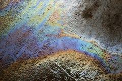 Текстура предпосылки нефтяного пятна на дороге стоковая фотография