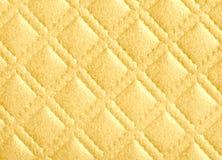 Текстура ромбовидного узора в цвете золота Стоковые Изображения
