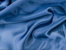 текстура сатинировки голубой ткани предпосылки естественная Стоковое Изображение RF