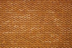 Текстура связанного желтым цветом макроса ткани Стоковая Фотография