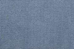 Текстура связанной сер-голубой шерстяной ткани Стоковое Фото