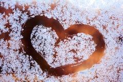 Текстура, сердце на морозном окне, Стоковое Изображение