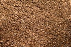 Текстура скомканной бронзовой фольги стоковые фото