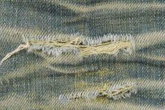 Текстура сорванная джинсами стоковое фото rf