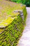 текстура солнечного света камня дороги предпосылки асфальта соответствующая Стоковые Изображения