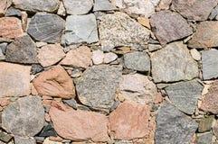 Текстура старой каменной стены больших грубых валунов Стоковое Фото