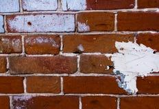 Текстура старой кирпичной кладки с краской пятнает стоковое фото rf