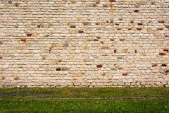 Текстура старой кирпичной стены в оранжевых и коричневых тенях Стоковые Фото