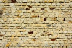 Текстура старой кирпичной стены в оранжевых и коричневых тенях Стоковая Фотография