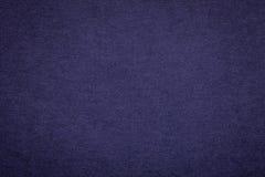 Текстура старой предпосылки голубой бумаги военно-морского флота, крупного плана Структура плотного темного картона джинсовой тка Стоковые Изображения