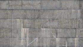 Текстура стены больших плиток гранита которые покрыты с белыми штриховатостями подверганный действию к dampnes Стоковое фото RF
