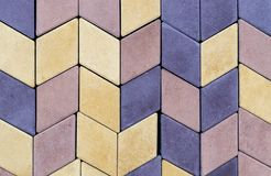 Текстура стены вымощая плиты других цветов для конструкции Смотреть на строительный материал стоковые изображения