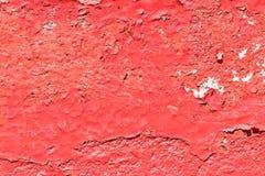 Текстура стены с старой краской красного цвета шелушения Стоковая Фотография