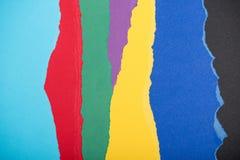 Текстура сделанная сорванных красочных бумажных частей Стоковое Фото