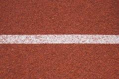 Текстура следа атлетики всепогодная идущая Стоковая Фотография RF