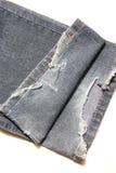 Текстура ткани джинсовой ткани сломанная джинсами Стоковое фото RF
