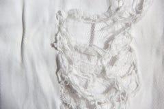Текстура ткани джинсовой ткани сломанная джинсами Стоковая Фотография