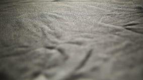 Текстура ткани, предпосылка ткани Крупный план ткани, серая linen ткань с большой текстурой Даже ровная предпосылка ткани сток-видео