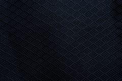 текстура ткани предпосылки черная Деталь материала ткани холста стоковые фото