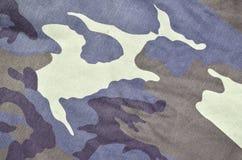 Текстура ткани при камуфлирование покрашенное в цветах болота Фоновое изображение армии Картина ткани камуфлирования войск Стоковые Изображения RF