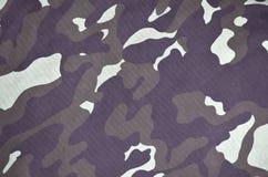 Текстура ткани при камуфлирование покрашенное в цветах болота Фоновое изображение армии Картина ткани камуфлирования войск Стоковая Фотография RF
