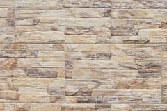 Текстура фото крупного плана кирпичной стены Естественное каменное внешнее оформление Желтая каменная поверхность кирпича совреме Стоковое Фото