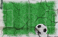 Текстура футбольного поля с шариком Стоковая Фотография