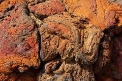 Текстура цвета камня лавы Lanzarote красная ржавая Стоковая Фотография