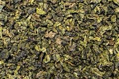 Текстура чая разбросала на поверхность таблицы Стоковые Изображения