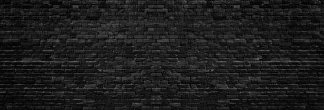 Текстура черной кирпичной стены широкая Предпосылка темной кирпичной кладки панорамная стоковое изображение