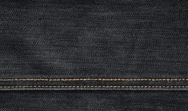 Текстура черной ткани джинсовой ткани Стоковая Фотография