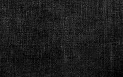 Текстура черноты ткани джинсов стоковые изображения rf