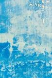 Текстурированная голубая стена с пятнами Стоковое Фото
