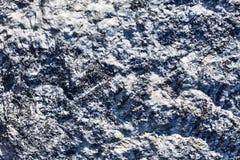 Текстурированная поверхность камня выбитая предпосылкой стоковая фотография