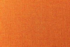 Текстурированная поверхность предпосылки конца-вверх мебели драпирования ткани Оранжевая структура ткани цвета стоковая фотография