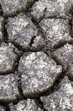 Текстурированная предпосылка сухой треснутой поверхности земли Стоковое Изображение RF