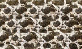 Текстурированные каменные стены построенные больших грубых камней, который держат совместно Стоковые Фотографии RF