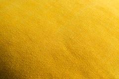 Текстурированный желтый цвет материала Стоковые Изображения RF