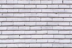 Текстурируйте представлять старую поврежденную покрашенную белизну кирпичной стены Стоковые Фото