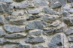 Текстурируйте старую стену от серой каменной России стоковая фотография