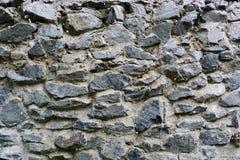Текстурируйте старую стену от серой каменной России стоковое изображение