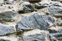 Текстурируйте старую стену от серой каменной России стоковые фото