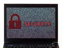 Текст безопасностью с красным замком над шифровать текстом на scre компьтер-книжки Стоковые Фотографии RF
