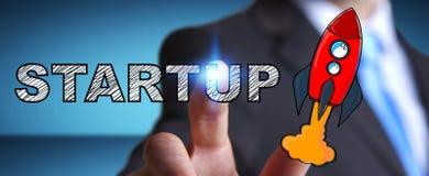 Текст бизнесмена касающей нарисованный рукой startup и красная ракета Стоковая Фотография